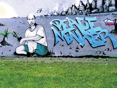«Миротворец» - такие граффити с изображением ПУТИНА рисуют в Сирии