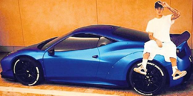 Джастин любит погонять на «Феррари-458 Италия» с ветерком, но и в голове у него - ветер